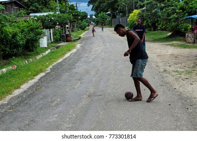 Dec2017, Honiara, Solomon Islands, a quiet side street in Honiara where boys can kick a ball around and smaller children play catch on the street