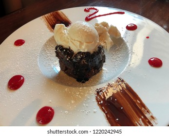 Decadent chocolate dessert topped with vanilla ice cream