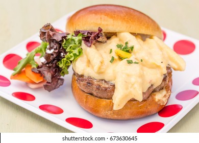 A decadent grilled turkey burger topped with macaroni and cheese