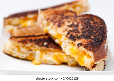 decadent mac & cheese sandwich with white and orange cheeses