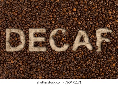 Decaf concept written on coffee beans and jute canvas fabric textile