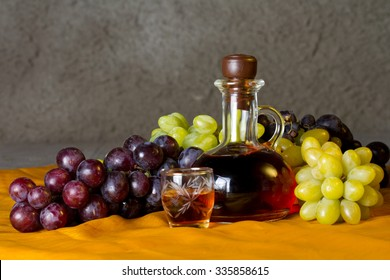 Decanter of brandy and grape