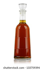 Decanter of brandy on a white background.