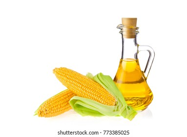 Decanter with farm organic vegetable oil and pair juicy corn cob, isolated on white background.