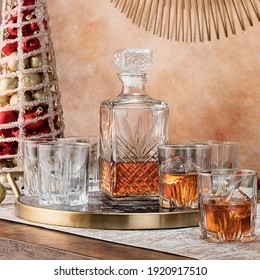 Decanter and glass of whiskey on a table