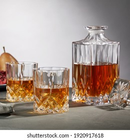 Decanter and glass of whiskey on table