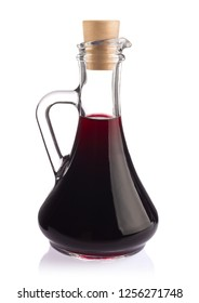 Decanter with red wine balsamic vinegar, isolated on white background.