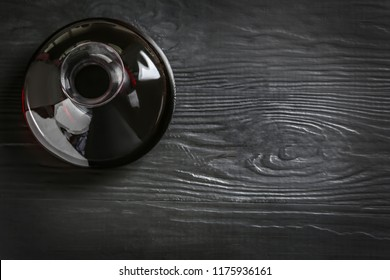 Decanter with red wine on wooden background, top view