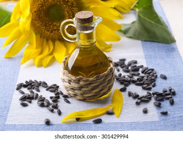 Decanter with sunflower oil and seeds.