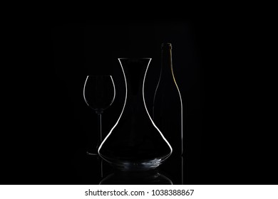 Decanter with wine glass and bottle on background