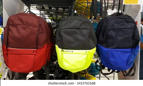 Decathlon, Salt Lake - 4.6.19: The back pack in three different  colour in the decathlon store are from quechua and Kipstar compant