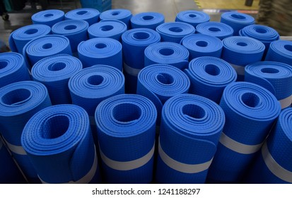 Decathlon, West Bengal / India - Nov 25 2018: Rolled Yoga mat on sale at Decathlon or Quechua the biggest shop which sells sports and mountaineering goods.