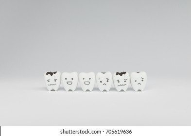 Decayed tooth model and good teeth for dental health care concept