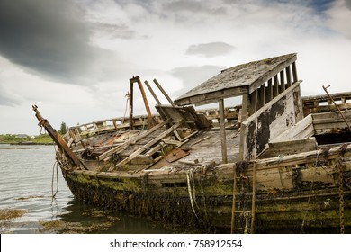 Decaying old wooden boat now a ship wreck