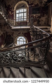 Decaying staircase in an abandoned house