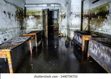 Decaying tables inside flooded Soviet fallout shelter.