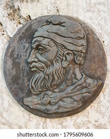 Decebalus king of Dacia portrait head sculpture. Dacian king decebal profile head bas relief sculpture on marble, in public square, Brad, Hunedoara, Romania