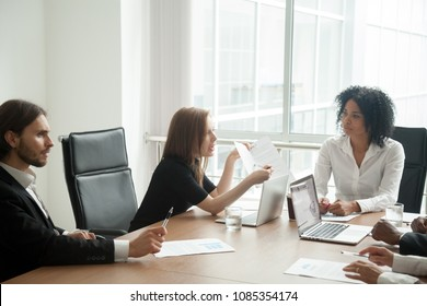 Deceived dissatisfied businesswoman having claims arguing about bad business contract terms disputing at meeting with diverse lawyer and partners demanding compensation, legal fight and fraud concept