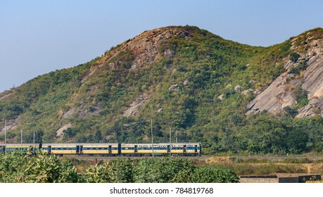 December 08,2016. Ranchi,Jharkhand, India.An Indian passenger train is passing by the range of mountains.