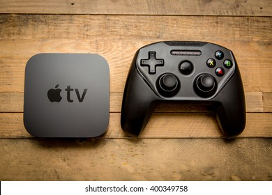 December 11, 2015. Toronto, Ontario, Canada. The new Apple TV 4th generation with the Nimbus SteelSeries bluetooth game controller for Apple TV and iOS devices.