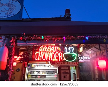 December 11, 2018 - Tony's Crab Shack in Bandon, Oregon, United States shows off bright neon signs offering crab, chowder and fish tacos