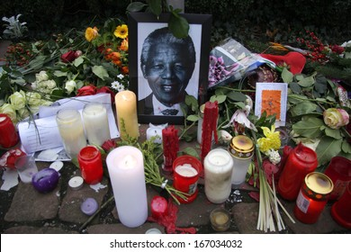 DECEMBER 12, 2013 - BERLIN: mourning for Nelson Mandela: flowers, candles and images at the South African Embassy in Berlin.