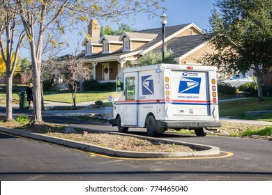 December 12, 2017 Livermore / CA / USA - USPS vehicle driving through a residential neighborhood on a sunny day