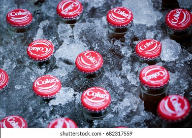 December 13, 2014, at Sam Chuk market in Suphan Buri, Thailand: The popular coca-cola bottles with their vintage-style red caps were put in an ice bucket to cool the drink