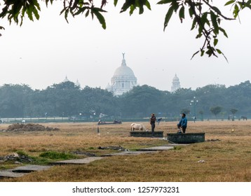 December 13,2018. Kolkata, India. People doing morning healthy activities at Maidan ground overlooking the Dome of Victoria memorial.