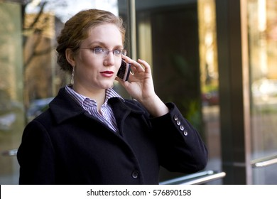 December 14, 2008, Washington, DC USA:  A Business woman talks outside on mobile phone.