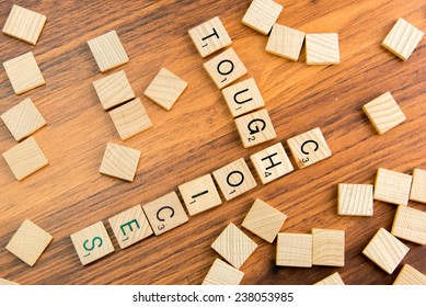 December 14, 2014 - Houston, Texas, USA - illustrative editorial of Scrabble tiles spelling TOUGH CHOICES
