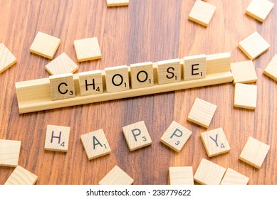 December 14, 2014: Houston, TX, USA - Scrabble tiles spelling CHOOSE HAPPY