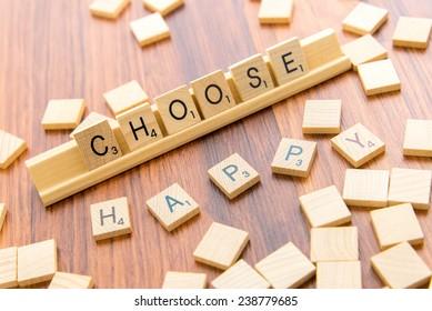 December 14, 2014: Houston, TX, USA - Scrabble tiles spelling CHOOSE HAPPY
