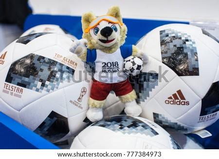 December 14, 2017 Moscow, Russia, Soft toys in the form of the official mascot of the 2018 FIFA World Cup Zabivaka wolf and official ball Adidas Telstar 18 in the official store.