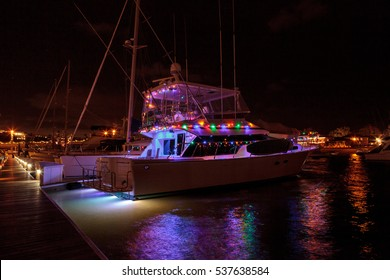 December 16, 2016?? Newport Beach, CA, USA: Colorful holiday lights on sailboats and ships in the Balboa Harbor for the Newport Beach Christmas Boat Parade. Editorial use only.