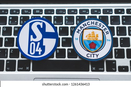 December 17, 2018. Nyon, Switzerland. Emblems of participants 1/8 finals of the UEFA Champions League season 2018/2019 Manchester City F.C. and Schalke 04 Gelsenkirchen on the computer keyboard.