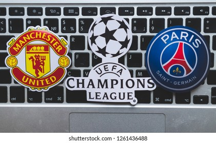 December 17, 2018. Nyon, Switzerland. Emblems of participants 1/8 finals of the UEFA Champions League season 2018/2019 Manchester United F.C.  and Paris Saint-Germain F.C. on the computer keyboard.