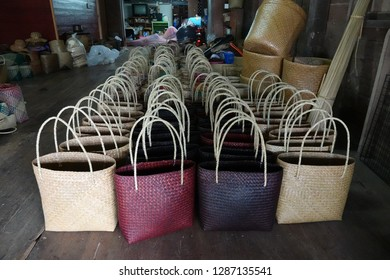 December 18, 2018 - Phatthalung, Thailand. Collection of new bags made from screwpine leaves and rattan at local factory owned by local entrepreneur in Thailand. Keywords with local words.