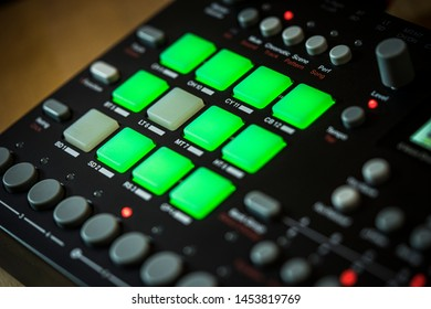 DECEMBER 19, 2018 - MALAGA, SPAIN. Electronic music production with an Elektron Analog Rytm drum machine. Green pads trigger different drum sounds.