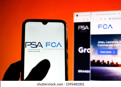 December 19, 2019, Brazil. In this photo illustration the Fiat Chrysler Automobiles and Groupe PSA logo is displayed on a smartphone and opened websites on blurred background.