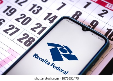 December 19, 2020, Brazil. In this photo illustration the Receita Federal logo seen displayed on a smartphone. Individual Income Tax concept