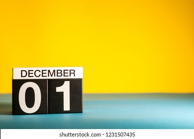 December 1st. Image 1 day of december month, calendar on yellow background. Winter background with empty space for text, mockup