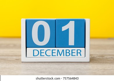 December 1st. Image of december 1 wooden color calendar on yellow background