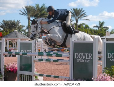 DECEMBER 2, 2017: Christoph Schroeder and Tarzan D'ivraie jump and take 2nd place in a class at the Holidays and Horses event by Equestrian Sports Productions in Wellington, Florida.