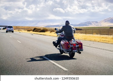 December 2, 2018 Los Angeles / CA / USA - Biker riding a Harley Davidson motorcycle on the interstate;