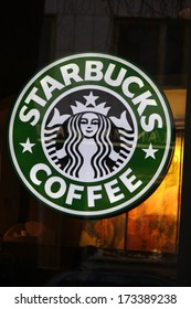 "DECEMBER 2013 - BERLIN: the logo of the brand ""Starbucks Coffee"", Berlin."