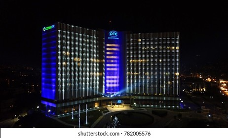 December 2015: Aerial drone bird's eye night view of illuminated public Hellenic Telecoms headquarters known as OTE, Marousi, Attica, Greece