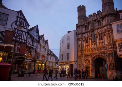 December 2015 - Butter Market square in Canterbury, UK, with tourists in front of entrance to Canterbury Cathedral, one of the oldest and most famous Christian structures in England