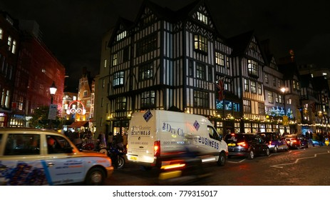 December 2016: Night shot from famous Oxford street in Christmas time, London, United Kingdom