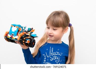 December, 2017. Minsk, Belarus.  STEM education. Little girl programmes Lego Boost Robot on Scratch. Battle. Robotics class for child and teen. School.  Mathematics.